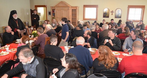 Archbishop BENJAMIN addresses parishioners at a festive meal in honor of our patron, St. Anthony.