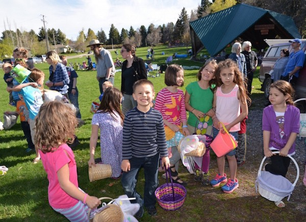 Young and old enjoy the parish picnic at Lindley Park.