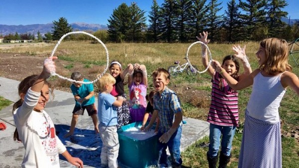 Parish children celebrate a birthday with after-church bubbles.