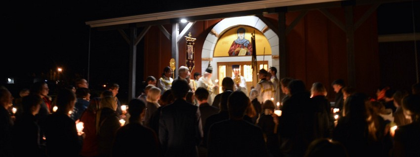 The faithful gather at the door of the church.