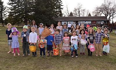 Parish children await the start of the egg hunt.