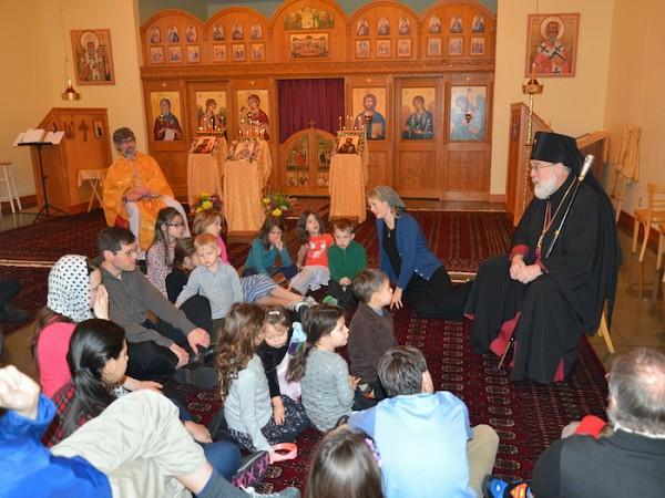 Archbishop BENJAMIN speaks with parish children.