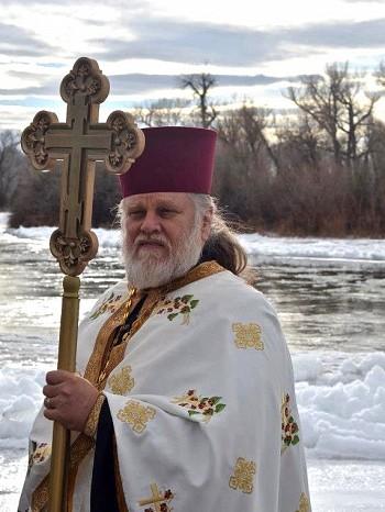Fr. Damien beside the river.