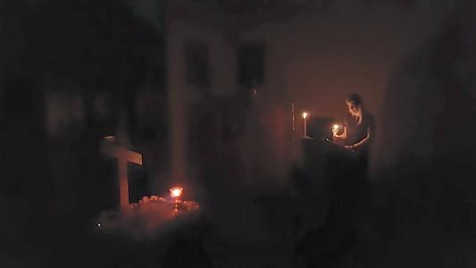 A parishioner reads psalms on Holy Friday.