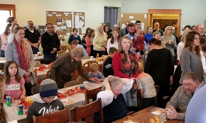 Parishioners gather for an early Thanksgiving potluck before the Advent fast begins.